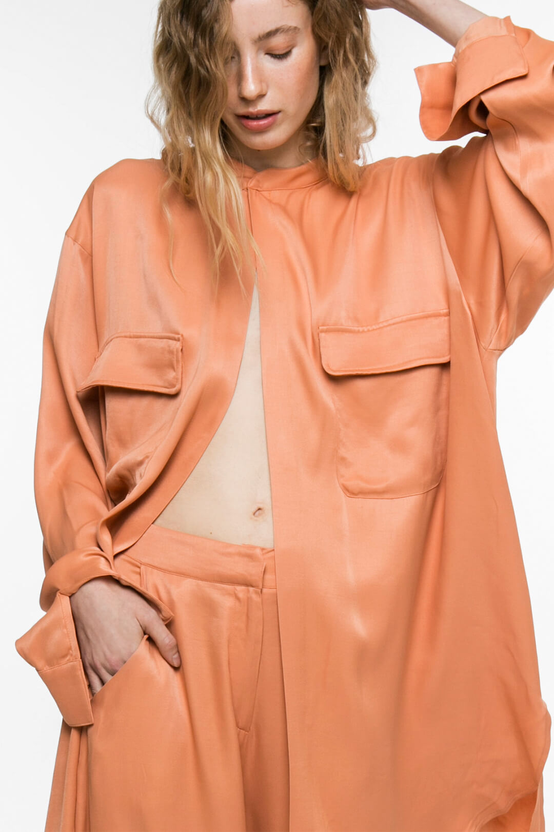 Peach pants with pockets on the side with pockets on the side